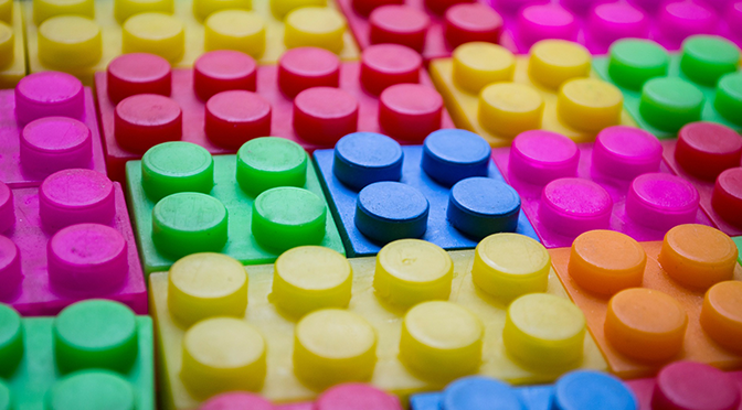Colourful childrens' building blocks laid out together
